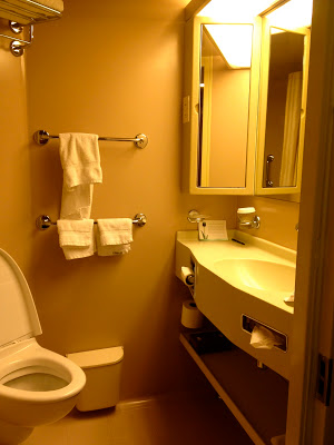 Interior stateroom bathroom with sink and mirror