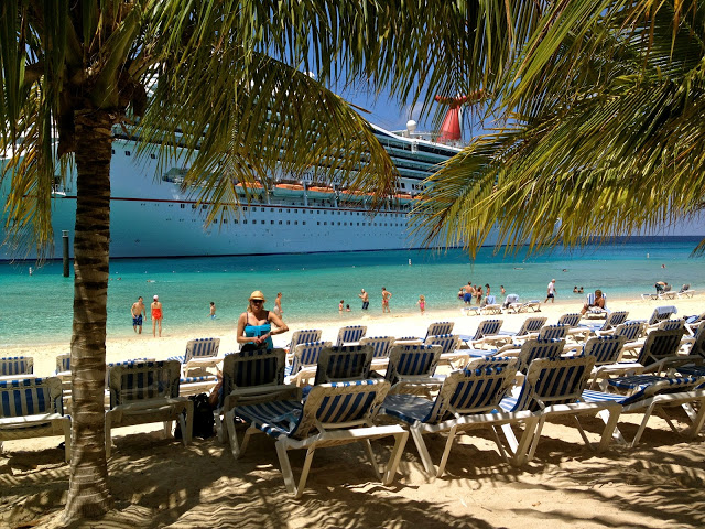 Beach with lounge chairs and palm trees at Grand Turk