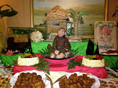 dessert buffet with monkey and hut sculpture