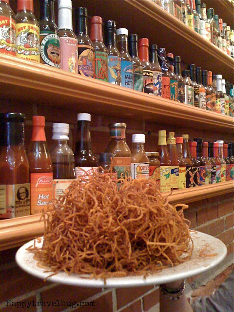 sweet potato nest with hot sauce bottles