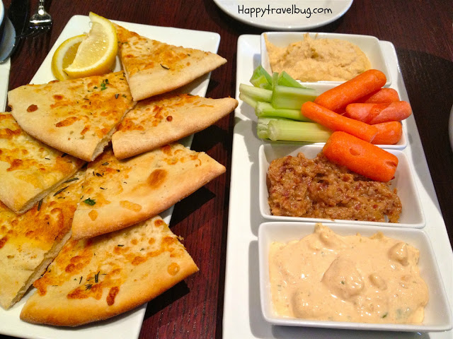 bread and veggies with 3 dips
