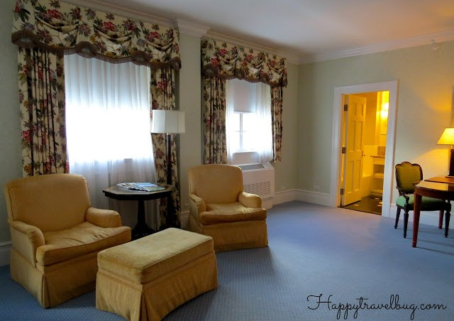 Seating, desk and bathroom entrance in our Greenbrier Hotel room