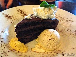 chocolate cake with cream anglaise and ice cream