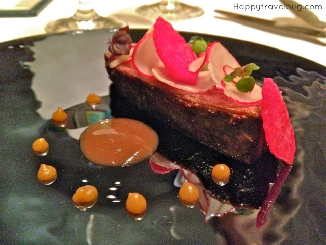 Wagyu beef short rib in aromatics, spiced radish, umeboshi from TRU restaurant in Chicago