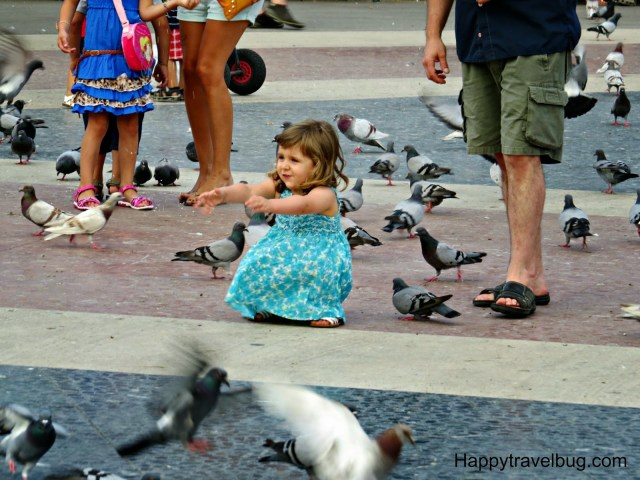 Little girl playing in Catalunya Plaza in Barcelona, Spain