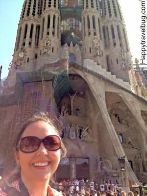Happy travel bug at La Sagrada Familia in Barcelona, Spain