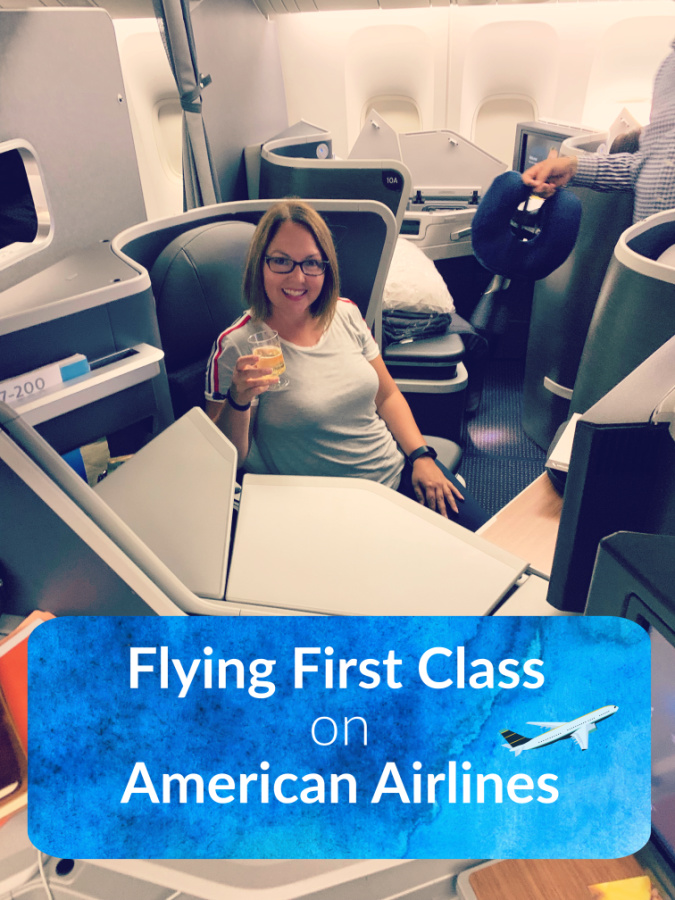 Woman sitting in first class section of an airplane