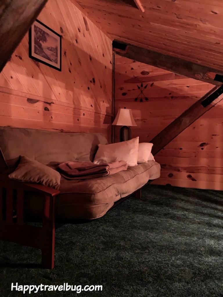 futon in log cabin loft