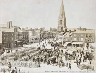 A postcard showing the sheep market in The Square, which still has markets selling a variety of food.
