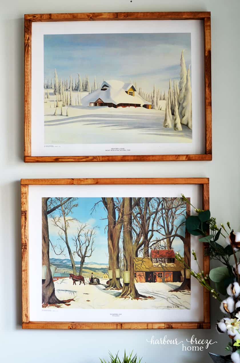 2 Farmhouse art prints hung in DIY picture frames