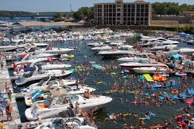 Harbor docks filled with boats and colorful floats with people on the water