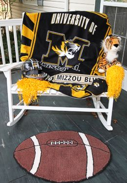 University of Missouri regalia on white porch bench and football shaped rug