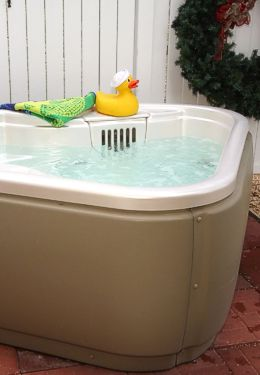 Whirlpool tub with white paneled walls and rubber ducky