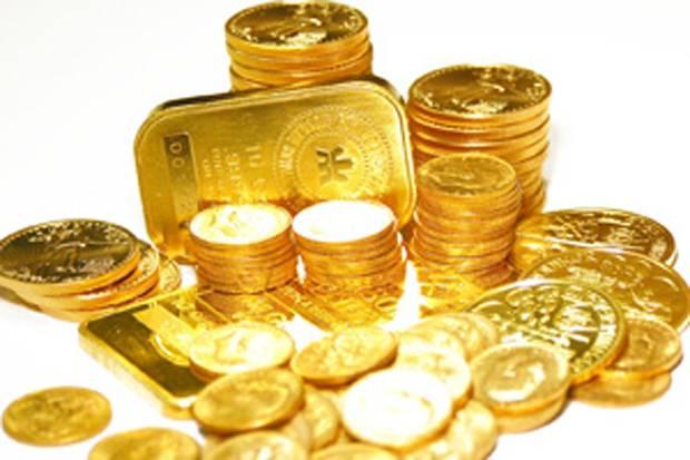 Emas global naik tipis harga emas Antam turun
