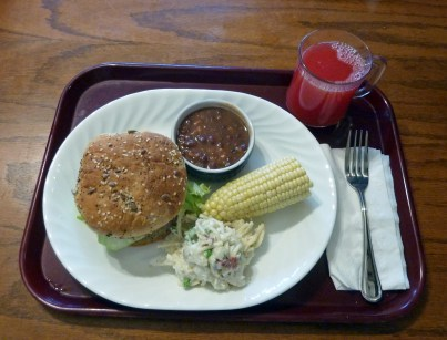All American veggie burger, ranch potato salad, steamed fresh sweet corn, baked beans, watermelon juice