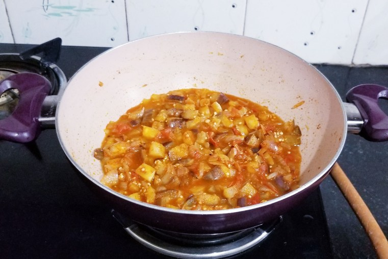 Brinjal curry is almost done.