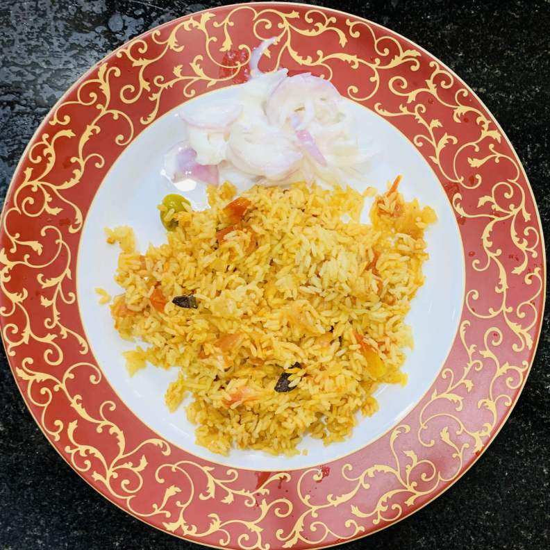 Yummy tomato rice recipe is ready to serve hot.