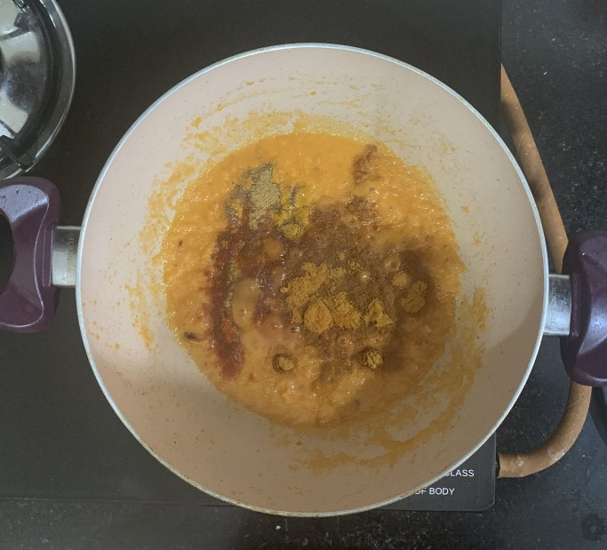 Then add all the spice powders and cook them until the raw smell goes off.