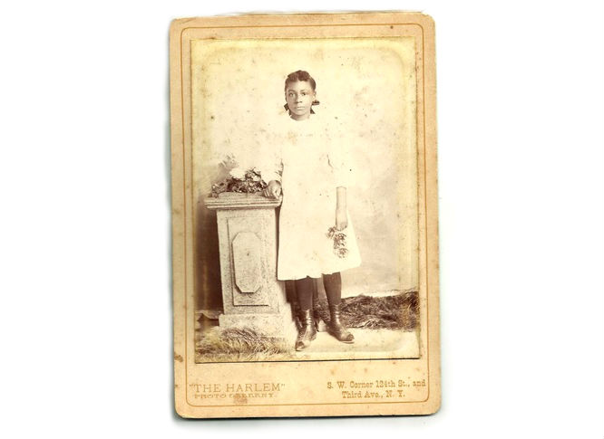 This is a very nice cabinet card of an attractive African-American girl in a white dress