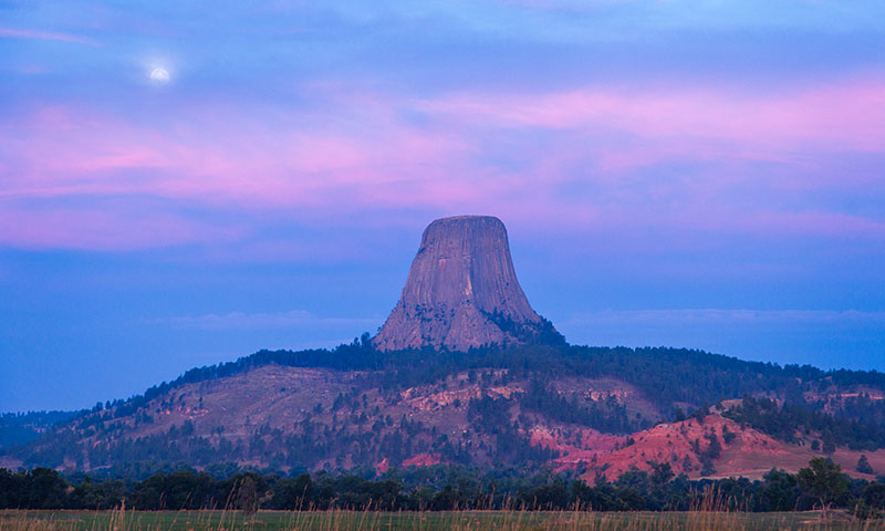The moon set behind Devil's Tower