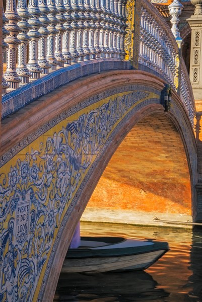 Plaza de España Rowboat peeks out from under a bridge