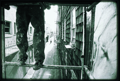 man standing on scaffolding