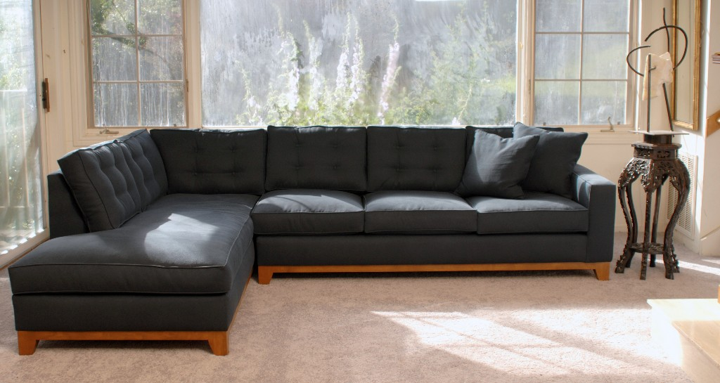 Navy blue sofa in a living room with decor