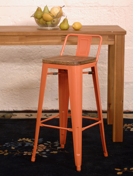 orange bar stool with a wooden seat at a tall table