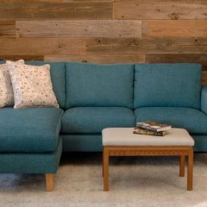 teal sofa in a living room with furniture and decor