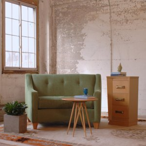 green sofa chair in a room with furniture and decor