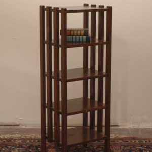 antique wood book shelf with decorative slats