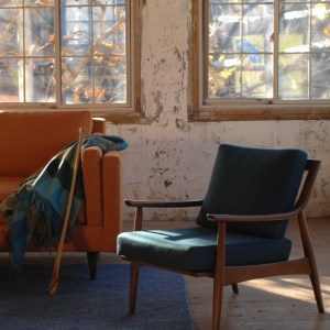 navy blue mid century modern arm chair in a living room