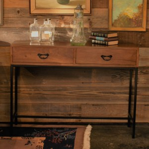 wood console table with metal base and accents