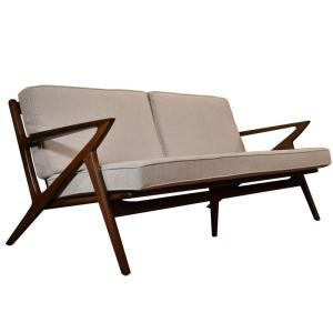 mid century modern style sofa with white cushions and a wood base