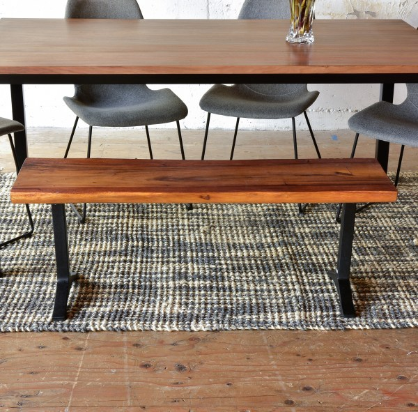 wood and steel bench at a dining table with chairs