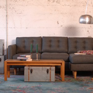 grey sofa in a living room with furniture and decor
