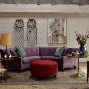 purple velvet sofa in a living room with furniture and decor