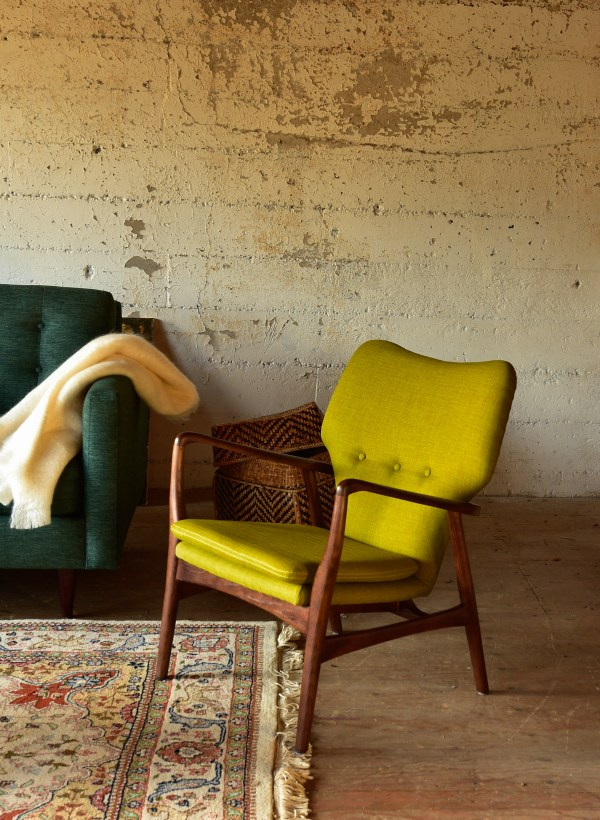 Chartreuse arm chair in a living room with furniture and decor