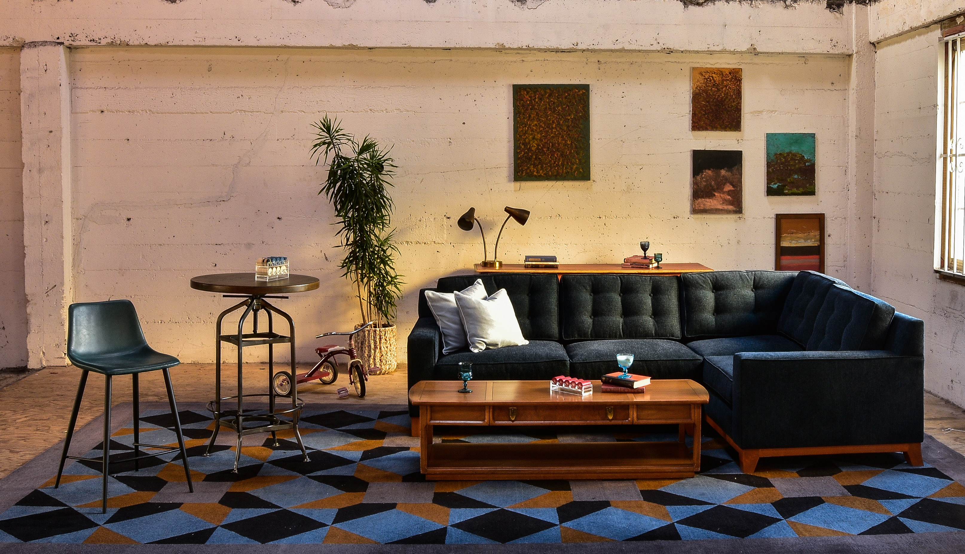 Blue sofa in living room with decor and plants