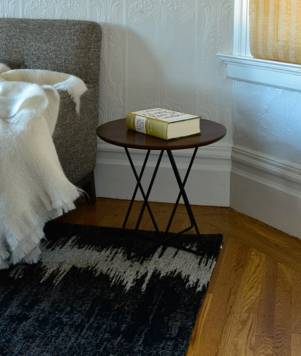 side table in bedroom with decor
