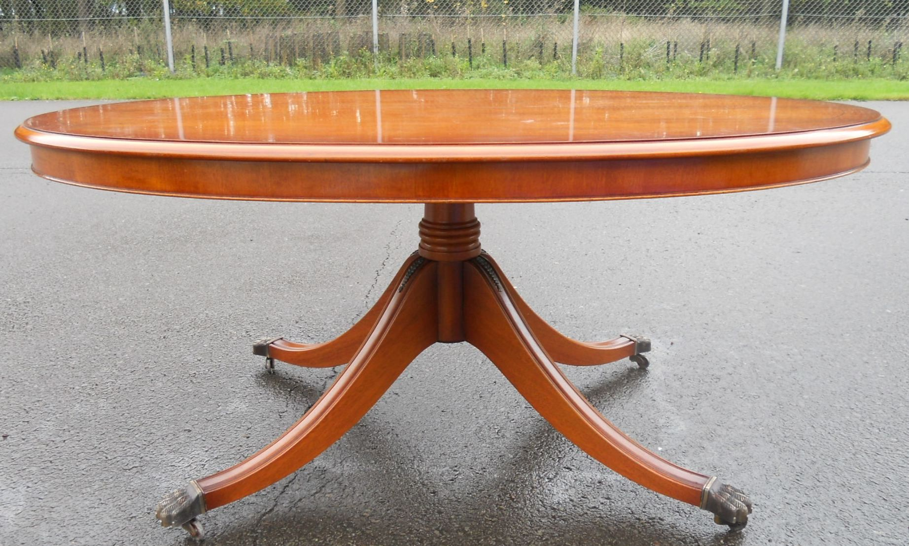 large yew oval pedestal coffee table by bradley