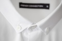 Close up of an ironed white mens cotton shirt