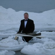 Extreme ironing surrounded by ice bergs.