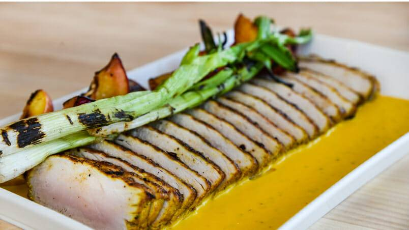 Grilled Curry Pork Loin With charred peaches and turmeric mustard sauce