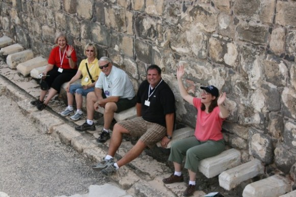 Lillian, Sandra, Bob, Allen and Kathy sitting on the 2000 year old toilets in Beit She'an.