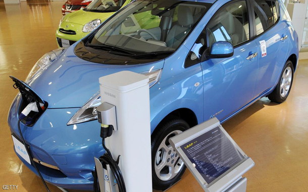 A Nissan Leaf electric vehicle is displa