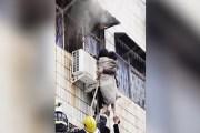 مشلول يتسلق مبنى محترق لإنقاذ امرأة حامل