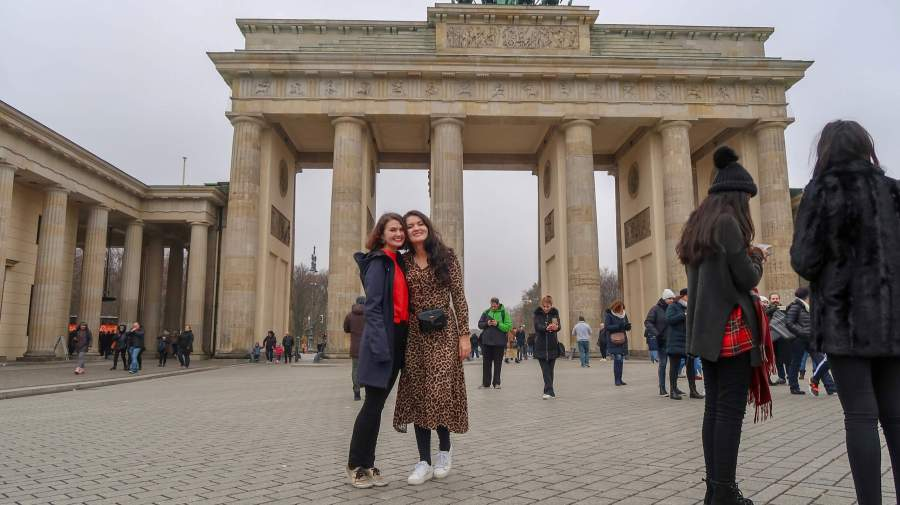 What to do in Berlin: Top 11 Tips by Hashtag Explorers' Melissa. This is a picture of me and my sister in front of the Brandenburger Tor.