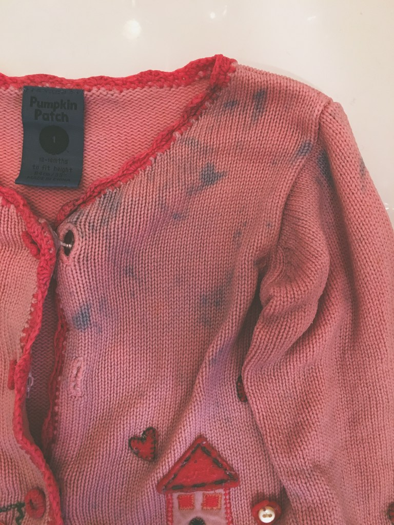 stained cardigan