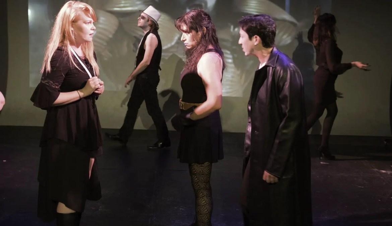Brenda confronts Fino; his bodyguard Jo glares at her.